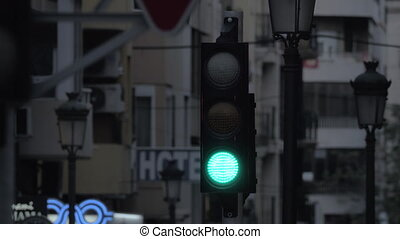 A closeup of a traffic light on a city street - A closeup of...
