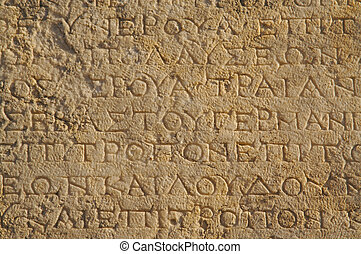 A closeup of ancient wall - A close up of ancient Greek text...