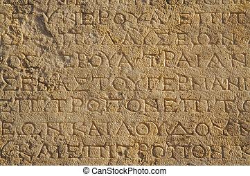 A closeup of ancient wall - A close up of ancient Greek text...