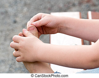 closeup of dirty feet of a little boy