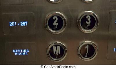 A closeup of hotel elevator buttons - A closeup of elevator...