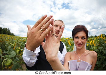 A closeup of newlyweds hands with wedding rings