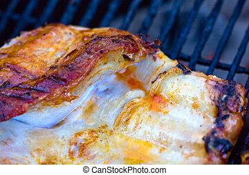 A closeup of pork ribs on grill.