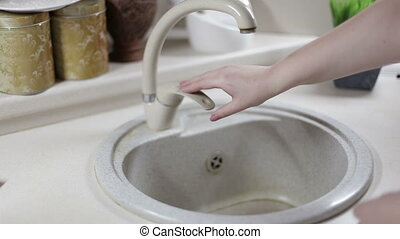 A closeup shot of a woman hand washing in the sink . Girl cleaning her hand .
