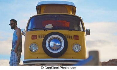 A closeup Yellow rv car near the sea. - A closeup Yellow rv...