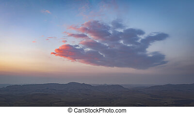 A Cloud at Sunrise over the Desert