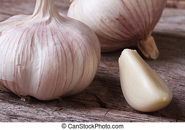 a clove of garlic and a whole wooden table closeup?
