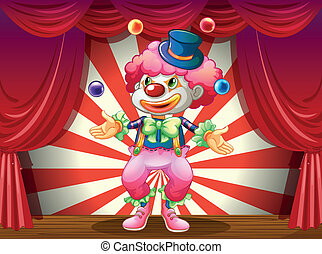 A clown at the center of the stage