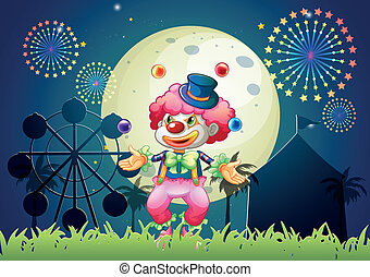 A clown juggling in front of the carnival