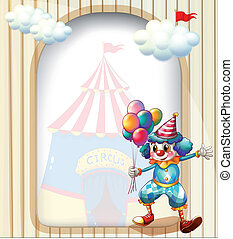 A clown with balloons at the entrance of the carnival