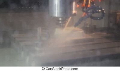 A CNC milling machine operating in industrial machinery ...