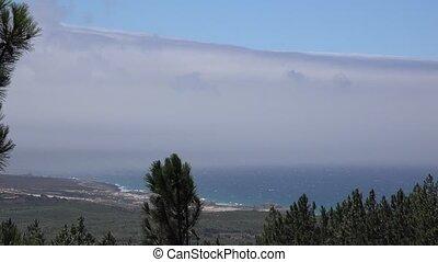 A Coastline And Clouds