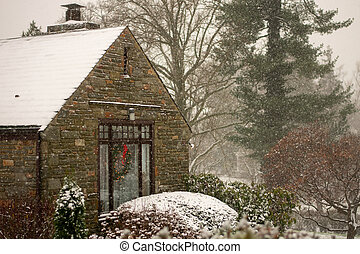 A Cobble Suburban Home and Street During a Snowstorm