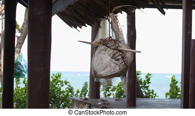 A coconut hanging design - A tight shot of a coconut hanging...