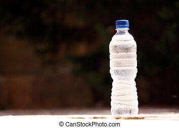cold bottle of water - a cold bottle of water with...