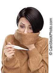 A cold young woman with a thermometer