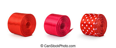 a collection of rolls of red ribbon isolated on white background