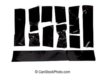 A collection of used black electrical tape pieces isolated on white background