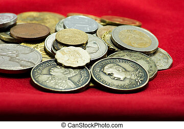 a collection of various currencies coin from countries the globe