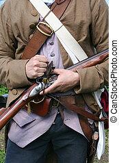Colonial Militiaman - A Colonial Militiaman Readies His...