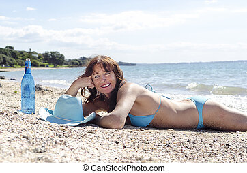 Happy smiling mature woman laying o