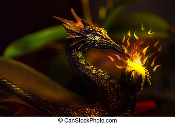 A colorful ancient dragon statue holding a sparkling ball of lig
