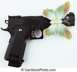 butterfly - A colorful butterfly with a gun