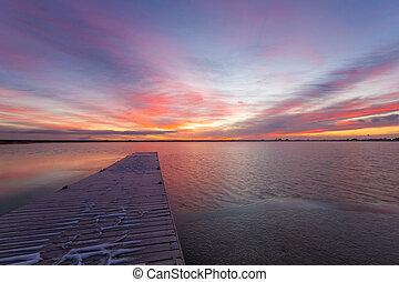Colorful Colorado Sunrise at Lon Hagler reservoir in Loveland Colorado