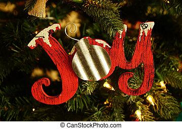 Colorful Joy Christmas ornament on Christmas Tree