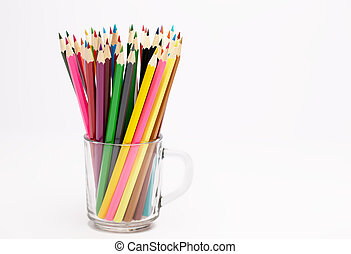 Colorful wooden pencils stand in a pencil holder