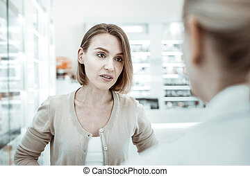 A comely lady in her 30s asking for pharmacist s advice