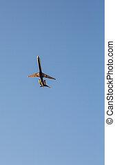 Jet Airplane Rising into Blue Sky