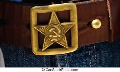 A communism logo on a belt - A close up shot of a communism...