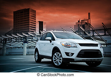 A compact SUV. - A compact SUV in the city. Dramatic sky.