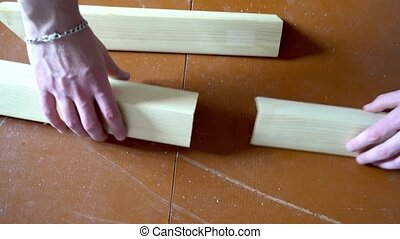 a comparison of the two wooden bars with your hands