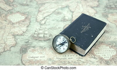 A compass and a book on a map