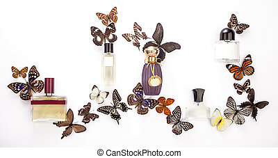 A composition of perfume bottles with butterflies on white background