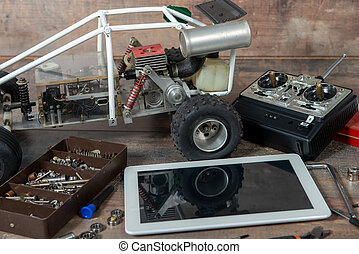 computer tablet with RC radio control car and tools - a ...
