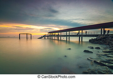 A concrete jetty near a resort