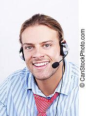 A confident business man. Smiling