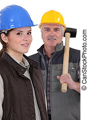 A construction worker and his apprentice.