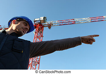 A construction worker showing directions.