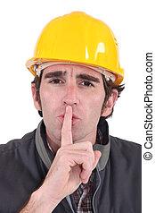 A construction worker shushing.
