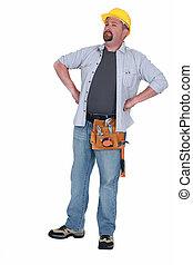 A construction worker standing.
