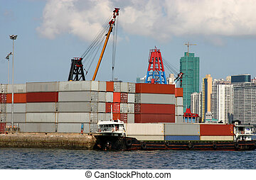A container barge being loaded with containers in Victoria...