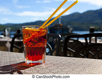 a cool drink with the lake in the background