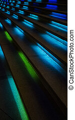 A cool futuristic looking staircase with blue lighting