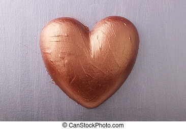 heart - A copper heart on silver background