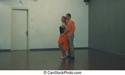 A couple dancing in the hall