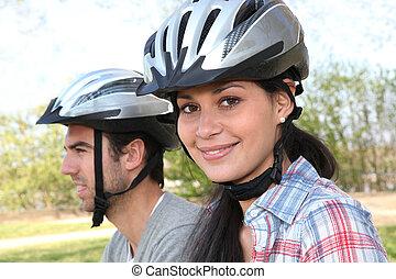 a couple doing mountain bike